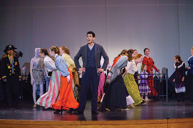 James Vair and the ensemble onstage at Cross Community Players' Mary Poppins