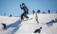 A snowboarder goes airborne at the Elm Creek Park Reserve