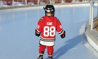 Little Boy Ice Skating in a Hockey Uniform