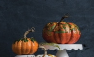 Three hand-decorated pumpkin centerpieces.