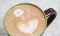 Eric Adolphson makes latte coffee art at the Daily Dose in Maple Grove.