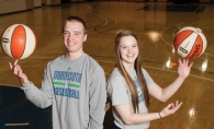 Brandon and Mackenzie Barta demonstrate their ball handling skills on the Minnesota Lynx practice court at Target Center.