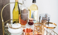 Aperitifs and digestifs sit on a bar cart.