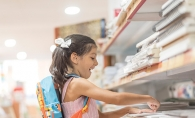 A girl shops for back to school supplies.