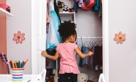 A child cleans their closet.
