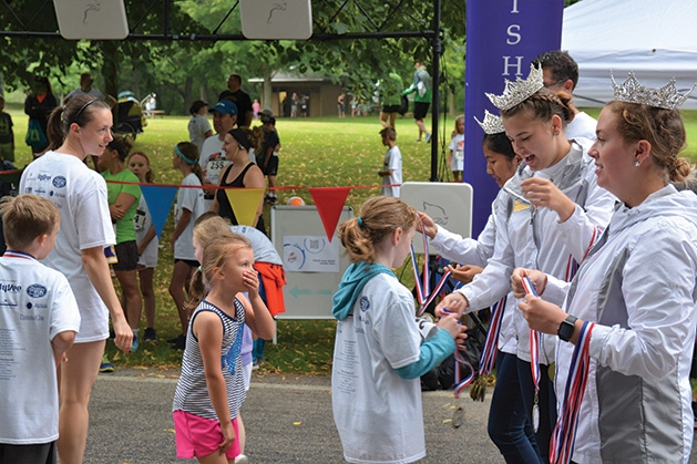 Medals are royally handed out at the finish line at the 9th annual Reading is Fun 5K