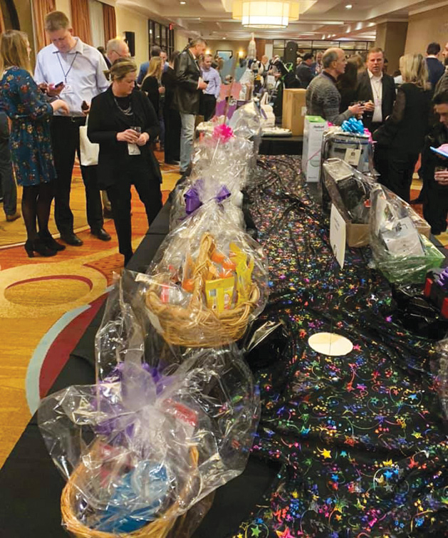 Silent auction tables at A Night Out of This World.