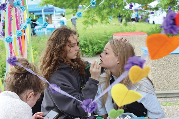 A girl gets her face painted at the Feeding Furry Friends Family Fun Day.