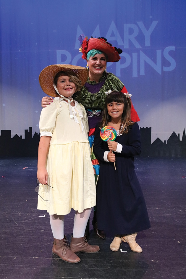 Nina Jonson, Zinnia Jonson and Adella Jonson onstage at Cross Community Players' Mary Poppins