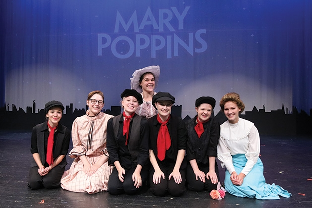 Heather Kok, Nora Vladimirova, Keili Anderson, Abigail Hawkinson, Kayla Hotlzer, Zoe Carter and Gracelynn Billings onstage at Cross Community Players' Mary Poppins