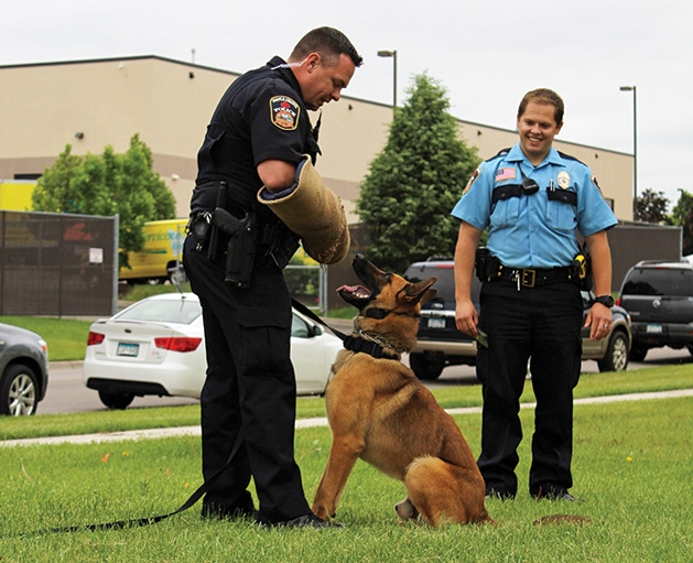 Officers perform a K9 demonstration at the Feeding Furry Friends Family Fun Day.