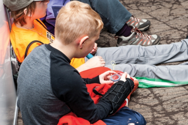 Orienteering students prepare for a hike