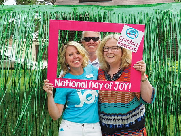 Jennifer Bauernfeind, Mark Carpenter (co-chair of Age Friendly Maple Grove) and Nany Carpenter (secretary of Age Friendly Maple Grove) at the Comfort Keepers National Day of Joy 2019