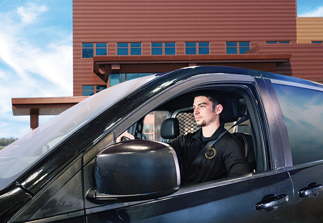 An SGI security guard provides secure transportation.