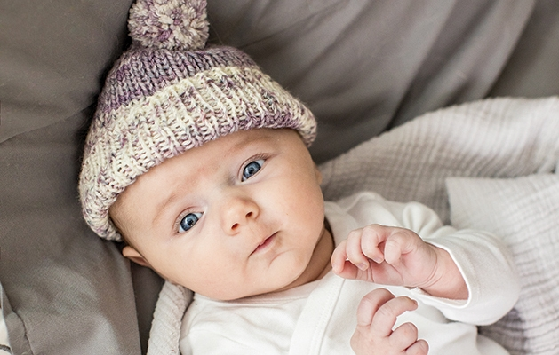 Baby wearing knitted hat.
