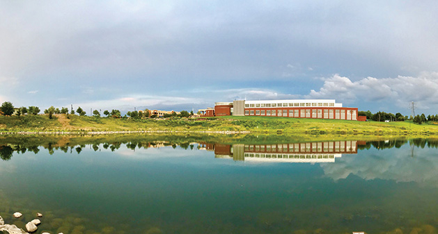A shot of the Maple Grove Government Center reflected in a nearby body of water.