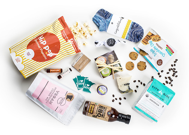 A collection of items from local brands which MN Brands for Good offers for fundraisers, including items from Triple Crown BBQ, Hip Pop Gourmet Popcorn, City Girl Coffee and more