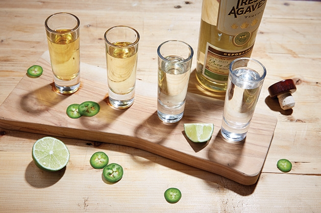 A tequila flight featuring different brands and types of tequila.