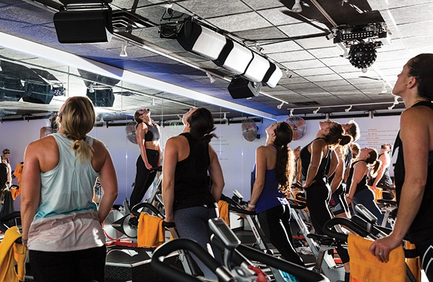 Participants cycle during a class at Surge Cycling in Maple Grove.