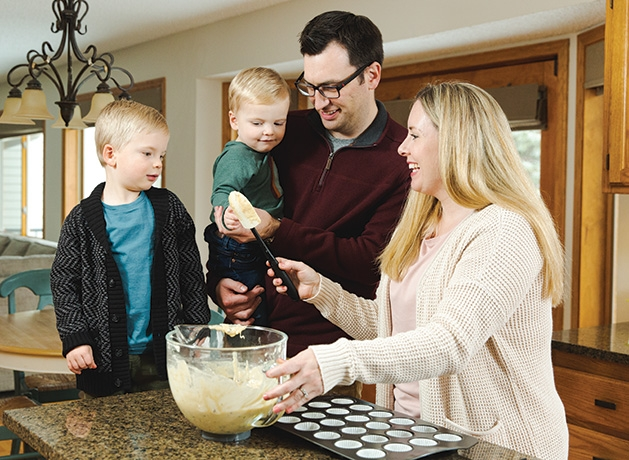 Nicole Pierson prepares a meal with her family.