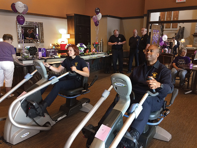 Members of law enforcement ride NuSteps at an Alzheimer's Association event.