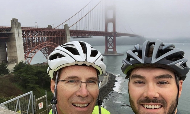 Brian and Jacobey Johnson at the Golden Gate Bridge during their Bike for Purpose fundraiser.