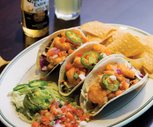 Firecracker shrimp tacos from Malone's Bar & Grill.