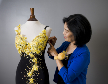 Ann Tran designs and alters clothing for her customers in Maple Grove