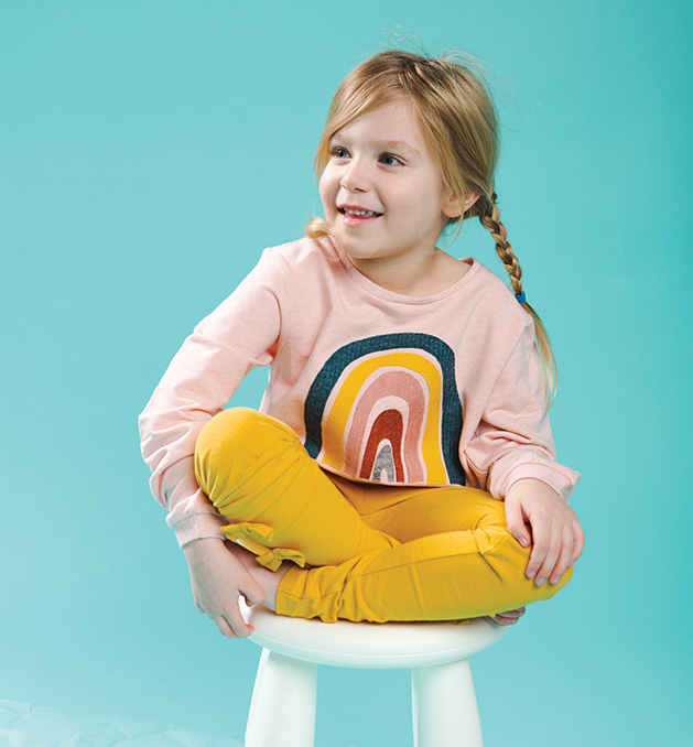 A child models clothing for Oh Baby!