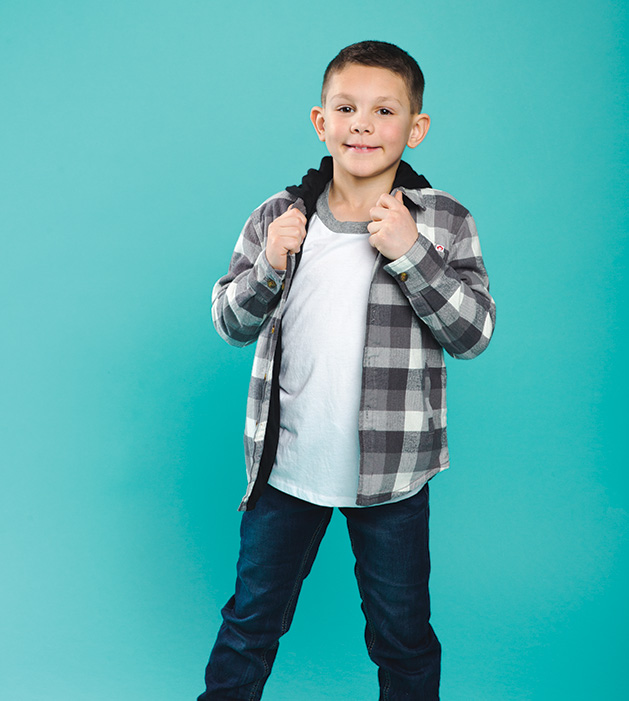 A child models clothing from Honey P's.