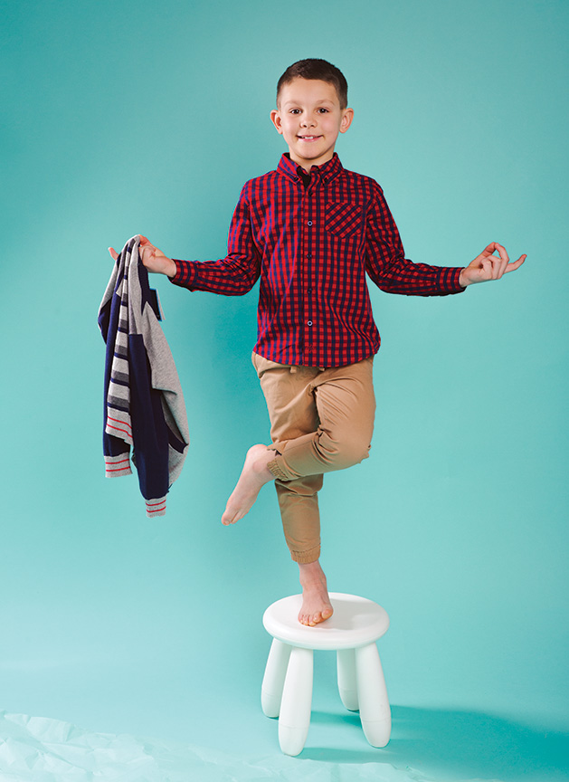 A child models clothing from Honey P's