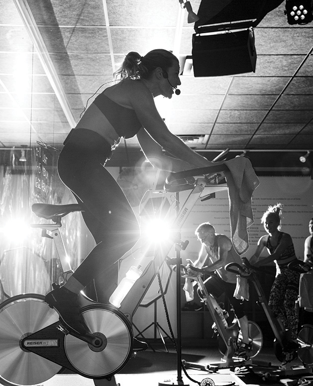 An instructor leads a cycling class at Surge Cycling in Maple Grove.